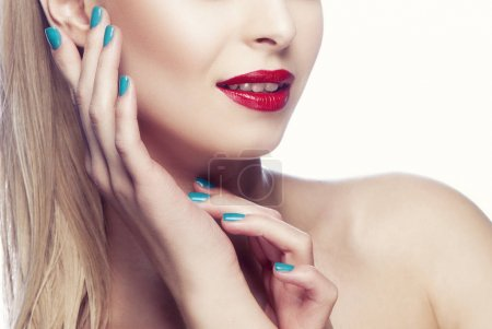 Photo for Partial view of woman portrait with modern red lips makeup and blue nail polish - Royalty Free Image