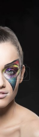 Photo for Cropped portrait of young woman with extraordinary makeup on black background - Royalty Free Image