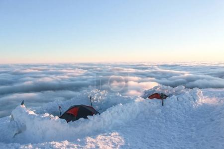 two tents on snowy mountain at sunrise, Carpathian Mountains, Ukraine