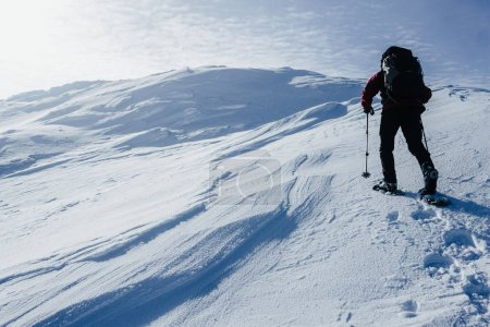 Photo for Scenic view of winter Gorgany mountains and determined climber - Royalty Free Image