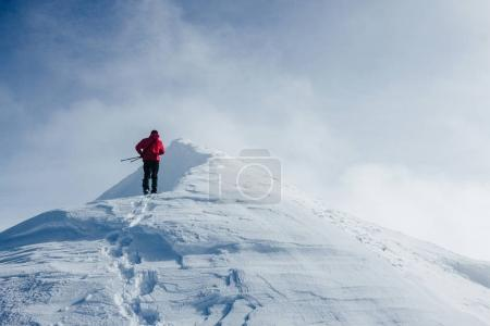 Photo for Traveler climbing Gorgany mountains in deep snow - Royalty Free Image