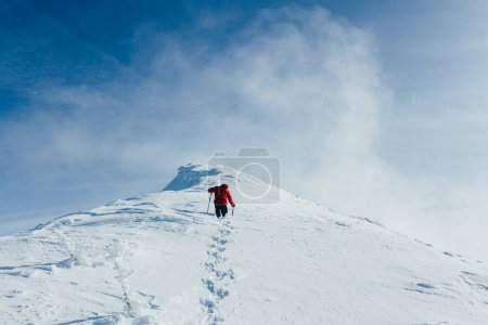 Photo for Footprints in snow behind climber in Gorgany mountains - Royalty Free Image