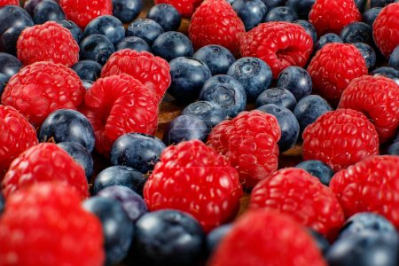 Photo for Closeup shot of mixed blueberries and raspberries. - Royalty Free Image