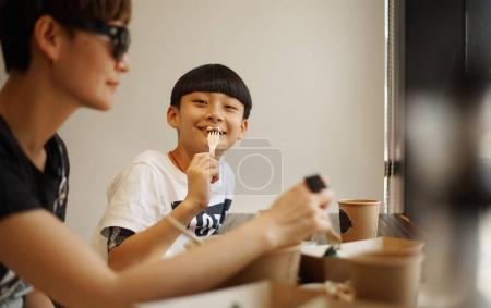 Chinese mother and son in restaurant