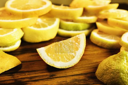 Beautiful wedge of lemon on  wooden table , in the...