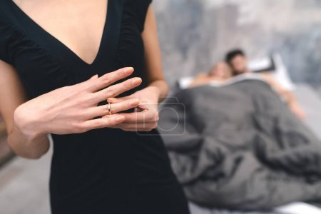 wife taking off golden ring after caught husband with mistress