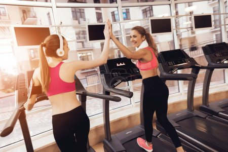 Photo for Women in sportswear running on treadmill at gym - Royalty Free Image
