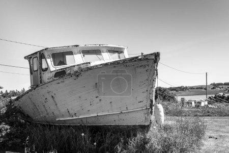 Abandoned fishing trawler at harbor, Victoria, Prince Edward Island, Canada