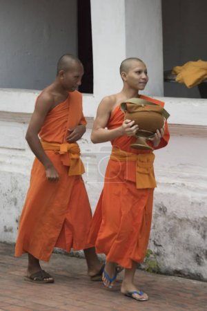 Monks walking outside temple, Luang Prabang, Laos