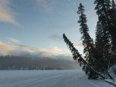 Frozen lake with snowcapped mountain range in the background, Pyramid Lake, Highway 16, Jasper, Jasper National Park, Alberta, Canada