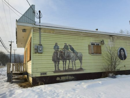 Mural of Cowboys on wall of a building in snow, Chetwynd, British Columbia, Canada