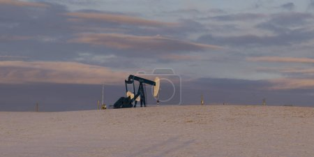 Oil well in snow covered field, Cowboy Trail, Alberta Highway 22, Alberta, Canada
