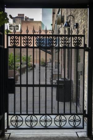 Photo for Closed gate amidst houses, Minneapolis, Hennepin County, Minnesota, USA - Royalty Free Image