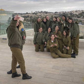 Group of female army soldiers of Israel Defense Forces taking selfie with smartphone, Old City, Jerusalem, Israel