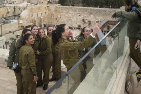 Group of female army soldiers of Israel Defense Forces with Western wall in the background, Old City, Jerusalem, Israel