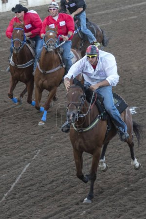 Jockeys riding horses at the annual Calgary Stampede, Calgary, Alberta, Canada