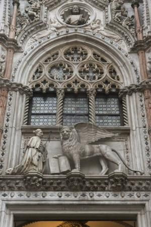 Statue of Winged Lion of St Marks and Doge adorns building, Doge's Palace, Venice, Veneto, Italy