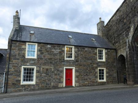 Photo for Facade of house with red door, Cullen, Moray, Scottish Highlands, Scotland - Royalty Free Image