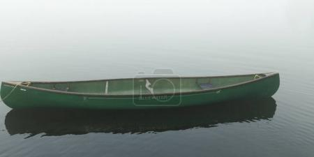 Photo for Canoe moored in the lake, Lake of The Woods, Ontario, Canada - Royalty Free Image