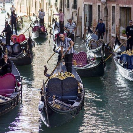 Gondolas on canal by buildings, Venice, Veneto, Italy
