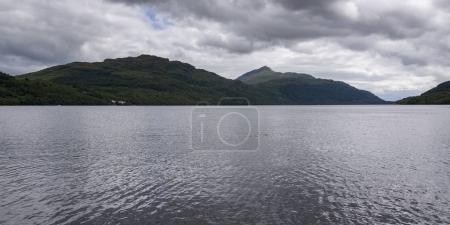 Scenic view of lake with mountains in background against cloudy sky, Arrochar, Loch Long, Argyll and Bute, Scotland