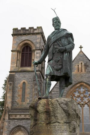 Statue in front of a church, Middle Street, Fort William, Scottish Highlands, Scotland