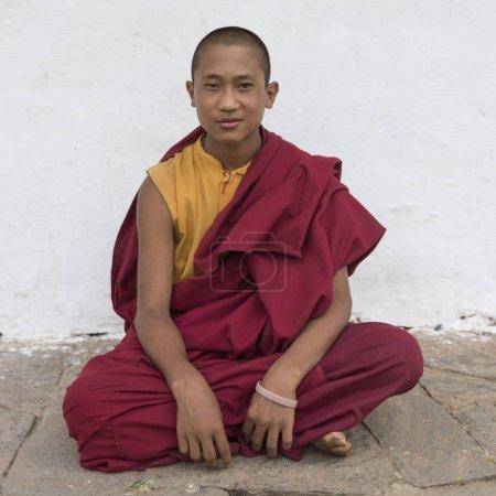 Buddhist monk sitting at Chimi Lhakhang, Punakha, Bhutan