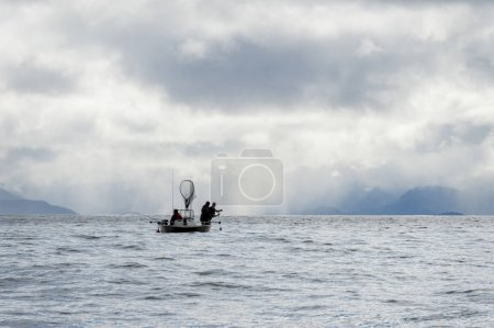 Tourist fishing in the Pacific Ocean, Skeena-Queen Charlotte Regional District, Haida Gwaii, Graham Island, British Columbia, Canada