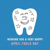 Cartoon tooth painted with doodles joke prank Happy April Fools Day! Dental illustration isolated on blue background Greeting card from dentistry