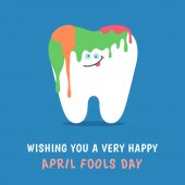 Coloring cartoon tooth with holiday greetings April Fools Day joke with colorful paints! Dental illustration isolated on blue background Greeting card from dentistry