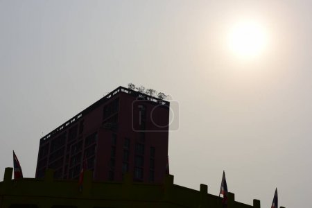 Photo for Skyscraper building on sunny sky background - Royalty Free Image