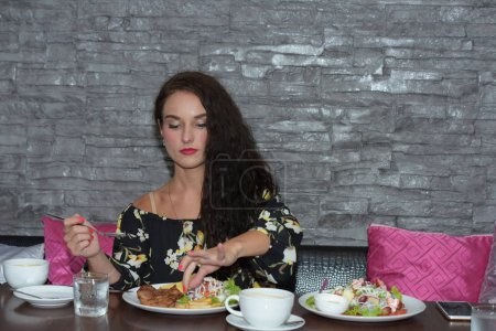 Photo for Women is eating and celebration in cafe - Royalty Free Image