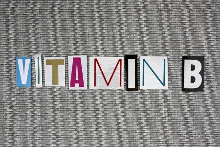 Vitamin B on grey background, medical concept...