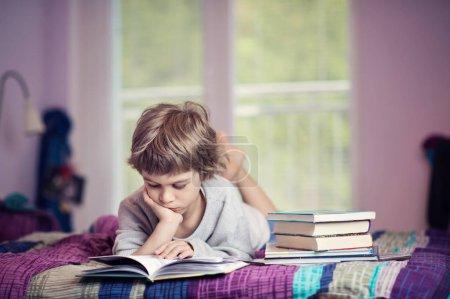 Cute little boy learning to read