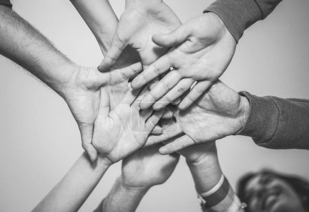 Photo for Close up of young teamwork putting their hands together for a new collaboration - Cheerful friends motivated on a plan - Friendship, team,  community concept - Royalty Free Image