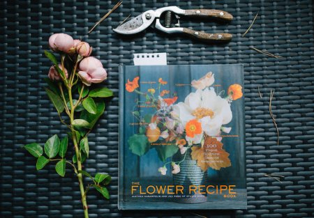 Photo for Top view of flower bouquet lying on table with book and scissors - Royalty Free Image