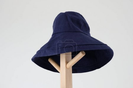 Photo for Wide brimmed sun hat on the coat rack - Royalty Free Image