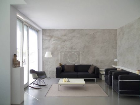 contemporary living room with rough cast wall
