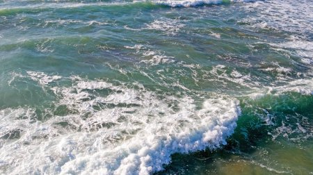 Photo for Aerial from ocean waves hitting the shore from the westcoast in Portugal - Royalty Free Image