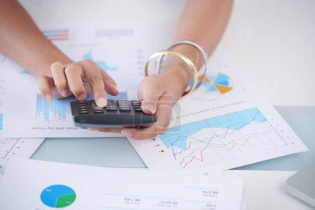female accountant calculating profit of company