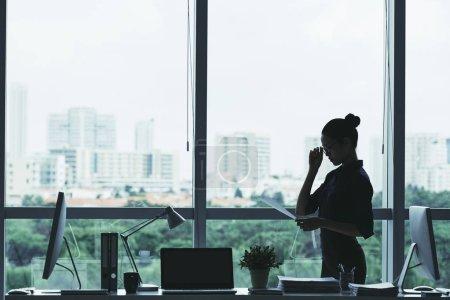 Female entrepreneur reading business contract