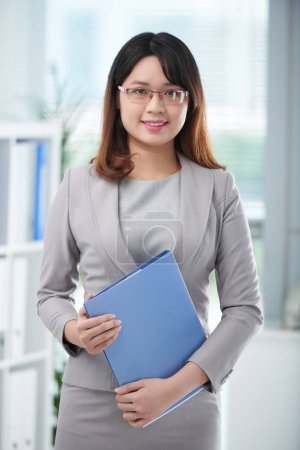 Photo for Pretty young business lady with folder of documents - Royalty Free Image
