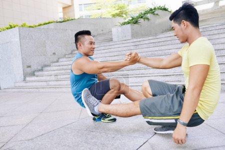 men practicing pistol squat outdoors