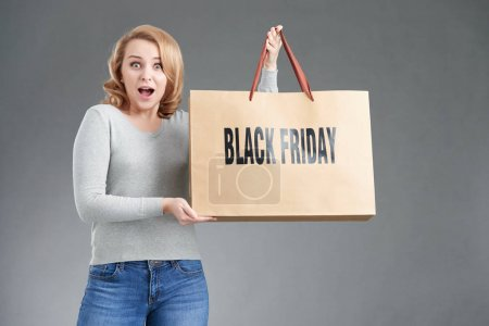 woman with Black Friday paper bag