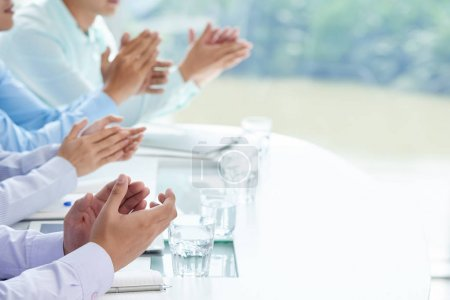 business people clapping to express support