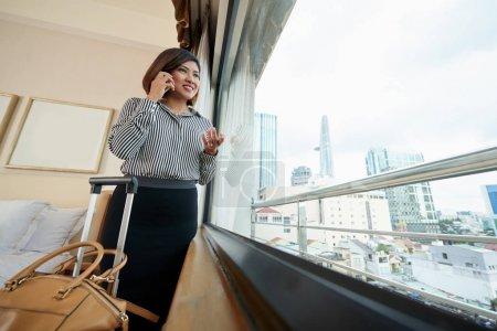 Business traveler talking on phone