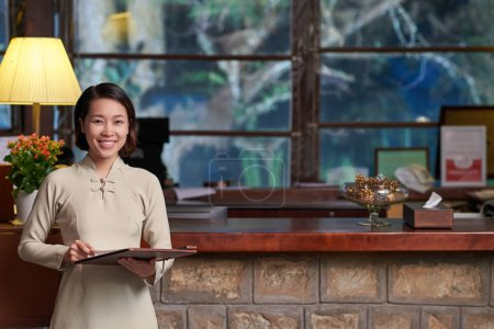 Vietnamese receptionist at workplace