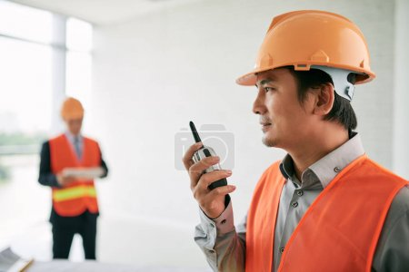 Contractor using walkie-talking for communication
