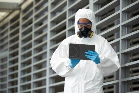 Scientist using digital tablet