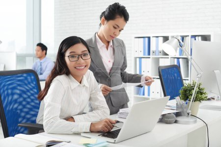 Photo for Beautiful Vietnamese business women working in office - Royalty Free Image